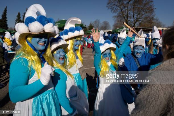 Participants talk to the press during a gathering of people dressed as smurfs to be counted as part of a world record attempt on February 16 2019 in...