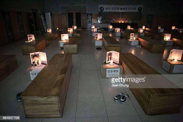 Participants think about their lives as they lie down in a coffin during a Death Experience/Fake Funeral session held by Happy Dying on August 1 2016...