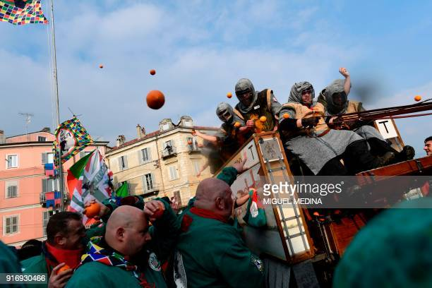Participants throw oranges from a float during the traditional Oranges battle of Ivrea Carnival near Turin on February 11 2018 Established in 1808...