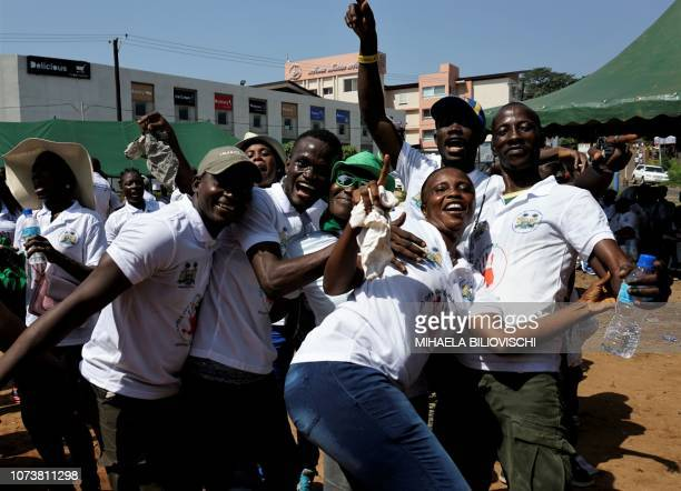 Participants to the Hands off our girls pose for a picture during a march through the streets of Freetown on December 15 2018 Hundreds of people...
