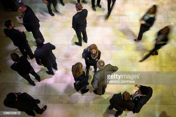 Participants to the World Economic Forum annual meeting are seen in the Congress Centre on January 22 2019 in Davos eastern Switzerland