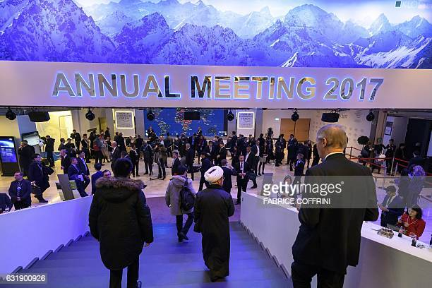 Participants to the World Economic Forum walk down the stairs in the Congress Centre on the opening day of the World Economic Forum on January 17...