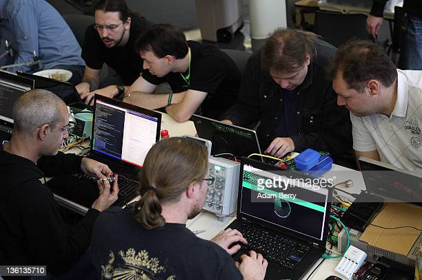 Participants use laptops on the first day of the 28th Chaos Communication Congress Behind Enemy Lines computer hacker conference on December 27 2011...