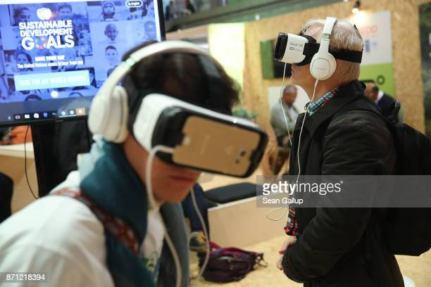 Participants view virtual reality films that show examples of United Nations sustainable development goals in Bonn Zone at the COP 23 United Nations...