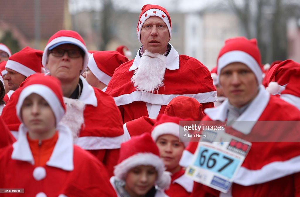 Participants wait for the start of the 5th annual Michendorf Santa Run (Michendorfer Nikolauslauf) on December 8, 2013 in Michendorf, Germany. Over 900 people took part in this year's races, which included one for children and one for adults.