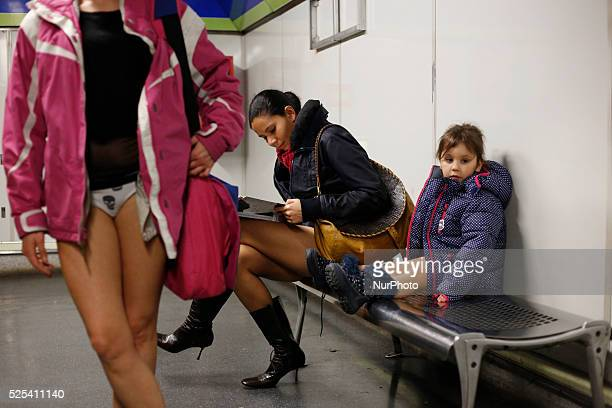 Participants wait for the underground in Gran Via station during the 5th edition of 'no pants subway ride' in Madrid Spain Jan sunday 12th 2014 The...