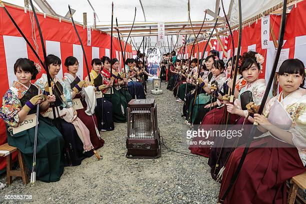 Participants wait for their turn in an archery event for 20yearolds to celebrate their comingofage at Sanjusangendo Temple on January 17 2016 in...