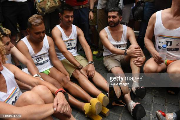 Participants wait in High Heels during the race Dozens of costumed men and women take part in the traditional gay pride high heels race in the Chueca...