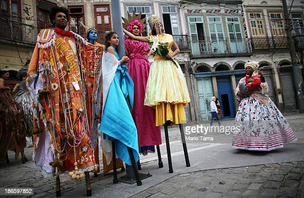 Participants wait to march in an All Saints' Day parade in the port district on November 1 2013 in Rio de Janeiro Brazil Brazilians will mark the Day...