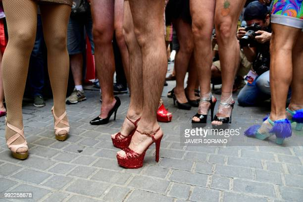 Participants wait to start the High Heels Race as part of the Gay Pride 2018 celebrations in Madrid on July 5 2018