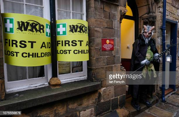 A participants waits by a lost children sign as he entertains crowds during the annual Whitby Krampus parade on December 01 2018 in Whitby England...