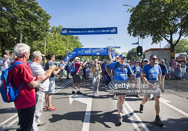 OUT*** Participants walk a special lap of honor prior to the 100th edition of the annual Four Day March of Nijmegen on July 18 2016 in Nijmegen The...