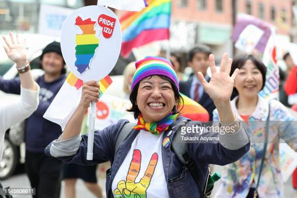 Participants walk down the street during the Tokyo Rainbow Pride Parade on April 28 2019 in Tokyo Japan Thousands from the Japanese LGBT community...