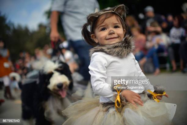 Participants walk during the Haute Dog Howl'oween Parade on October 29 2017 in Long Beach California
