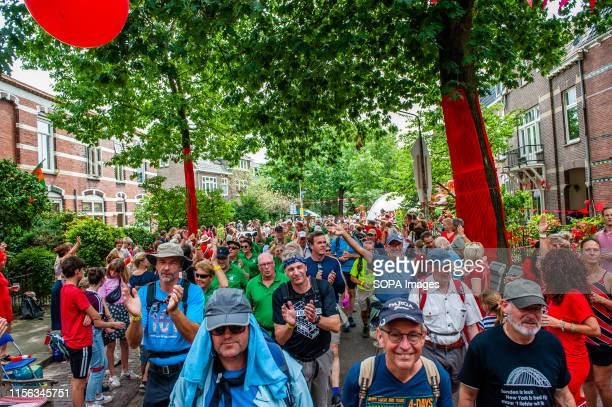 Participants walk in a neighbourhood decorated with red during the third day. Since it is the worlds biggest multi-day walking event, the Four Days...