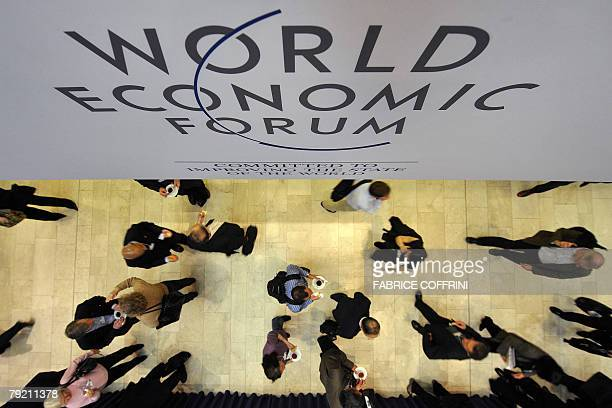 Participants walk in the Congress center at the World Economic Forum in Davos 25 January 2008 The annual Davos gathering of the world's political and...