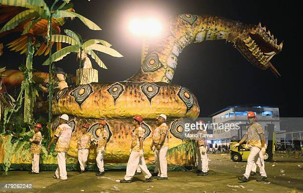 Participants walk past a snake float at the Parintins Folklore Festival in a town located along the Amazon River on June 27 2015 in Parintins Brazil...