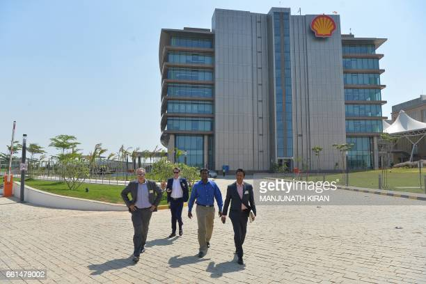 Participants walk through the Shell Technology Centre as it is opened in the Indian city of Bangalore on March 31 2017 Oil giant Shell opened March...
