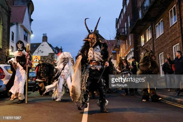 Participants walk through the streets during the annual Whitby Krampus parade on December 07 2019 in Whitby England The Krampus is a horned...