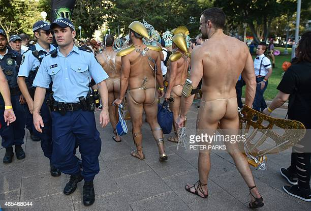 Participants walks past police before the start of the Sydney Gay and Lesbian Mardi Gras Parade in Sydney on March 7 2015 Around 10000 people took...