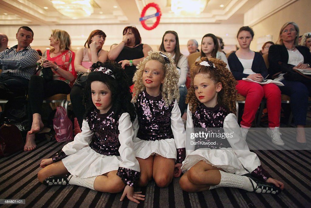 Participants watch as an under 11's dance group perform a Ceili dance during the World Irish Dance Championship on April 14, 2014 in London, England. The 44th World Irish Dance Championship is currently running at London's Hilton London Metropole hotel, and will host approximately 5,000 dancers competing in solo, Ceili, modern figure choreography and dance drama categories during the week long event.