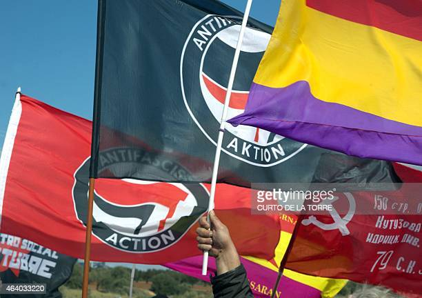 Participants wave republican and antifascist flags during a march called by the Friends of International Brigades Association to commemorate the...