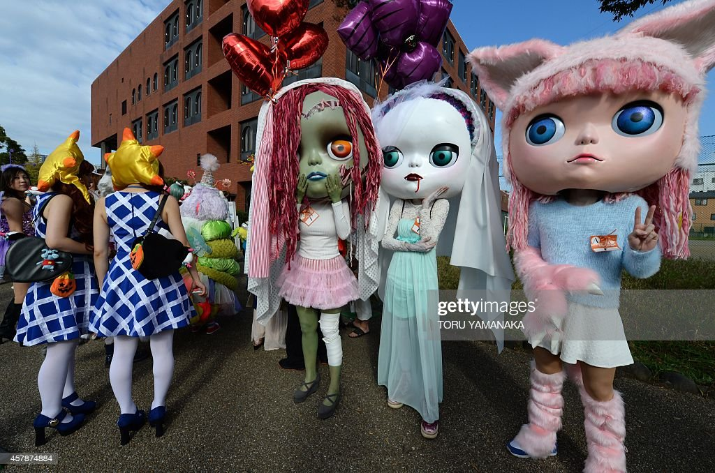 Participants wear costumes as they pose for pictures before the Halloween Parade in Kawasaki, a suburb of Tokyo, on October 26, 2014