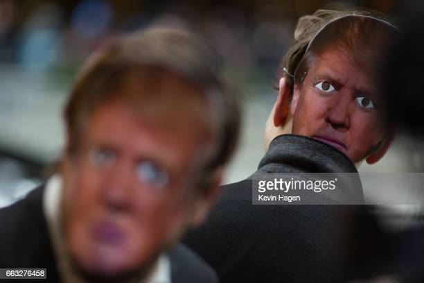 Participants wear President Trump masks as part of the event entitled New York City's 32nd Annual April Fools' Day Parade It's a Trumpathon on April...