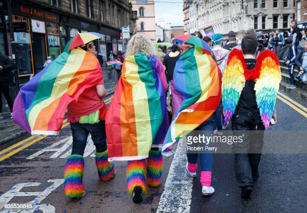 Participants wear rainbow flags and angel winfs during the Glasgow Pride march on August 19 2017 in Glasgow Scotland The largest festival of LGBTI...