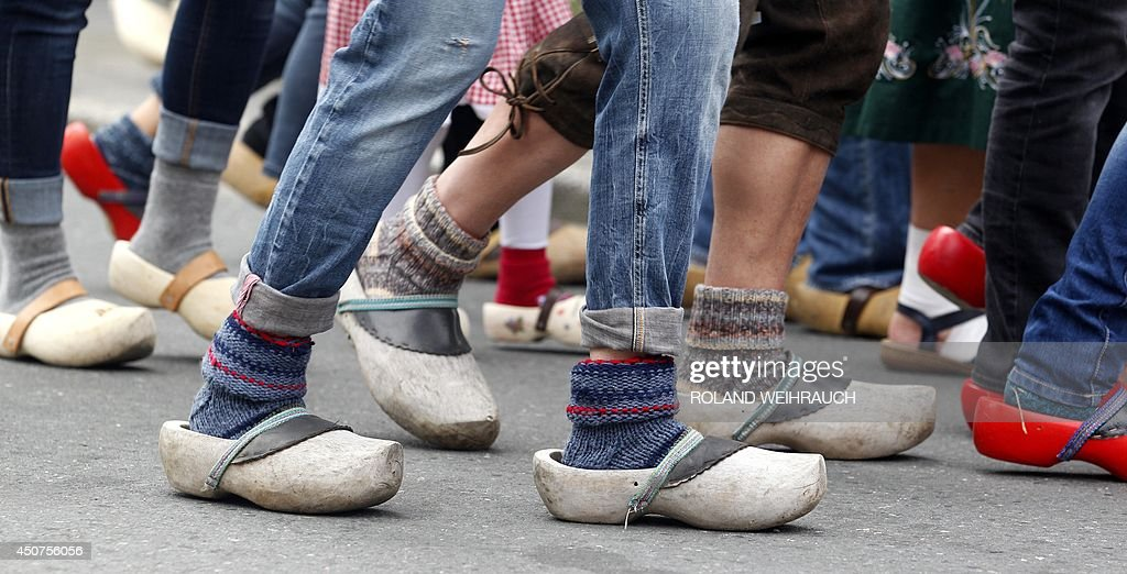 Participants Wear Traditional Dutch Wooden Shoes At A So Called
