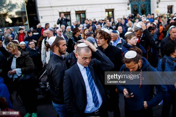 Participants wearing a kippah during a 'wear a kippah' gathering to protest against antiSemitism in front of the Jewish Community House on April 25...