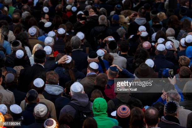 Participants wearing a kippah during a wear a kippah gathering to protest against antiSemitism in front of the Jewish Community House on April 25...