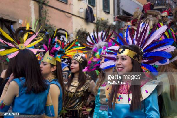 NAVE RONCIGLIONE VITERBO ITALY Participants wearing colorful costumes with head dress Carnival is a muchanticipated event in Italy and in many...
