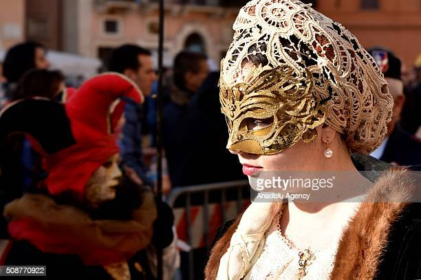 Participants wearing costumes are seen at the Piazza Navona one of the tourist area of the city during a carnival which is held every year on...
