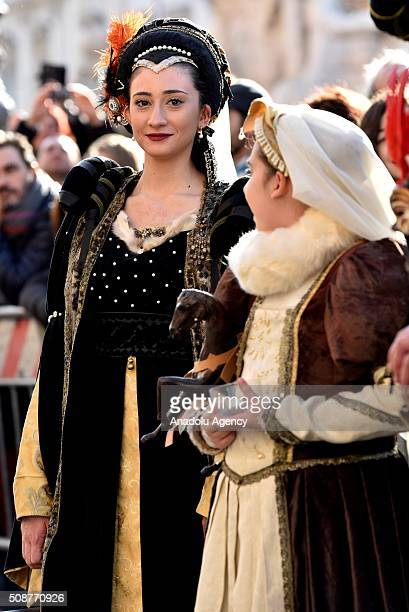 Participants wearing costumes are seen at the Piazza Navona, one of the tourist area of the city, during a carnival, which is held every year on...