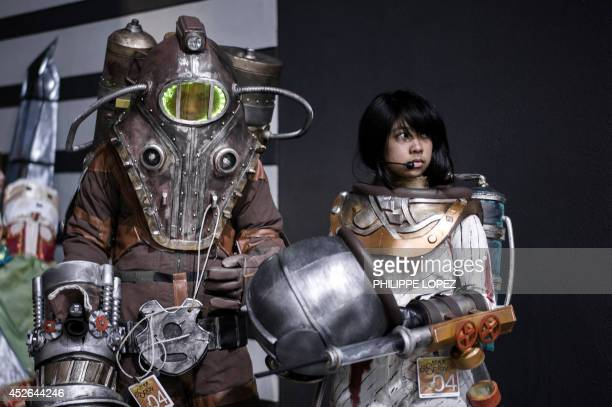 Participants wearing costumes depicting their favourite characters a trend known as cosplay Cosplay wait to get on stage at the 16th AniCom and Games...