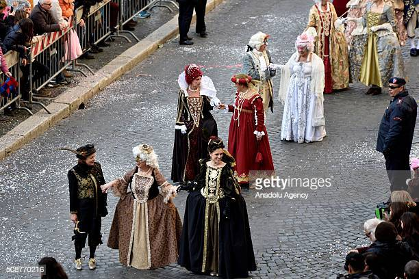 Participants wearing costumes parade at the Piazza Navona, one of the tourist area of the city, during a carnival, which is held every year on...
