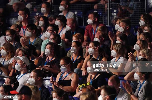 Participants wearing FFP2 protective face masks watch singer Tim Bendzko perform in the RESTART-19 Covid transmission risk assessment study in a...