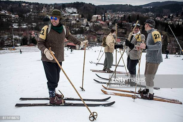Participants wearing historical ski attire prepare for a traditional ski race on February 20 2016 in Smrzovka Czech Republic Enthusiasts gathered in...