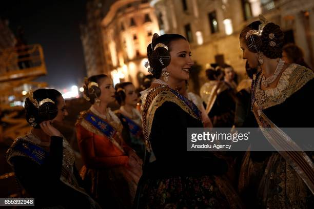 Participants wearing traditional costumes during the last day of Las Fallas festival in Valencia Spain on 19 March 2017 The Fallas festival takes...
