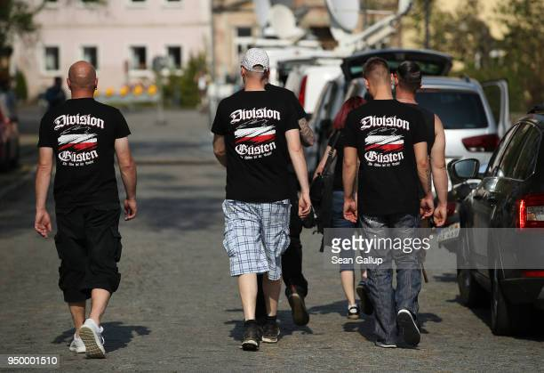 Participants wearing tshirts that read 'Division Guesten' arrive for a neoNazi music fest on April 21 2018 in Ostritz Germany By earky after noon...