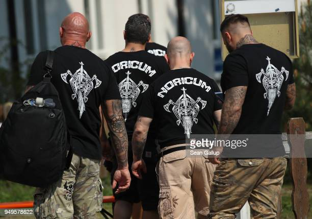 "Participants wearing t-shirts that read: ""Noricum"" arrive for a neo-Nazi music fest on April 21, 2018 in Ostritz, Germany. By earky after noon..."