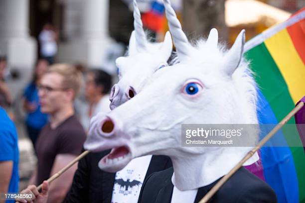 Participants wearing unicorn masks during a protest against homophobia in Russia on August 31 2013 in Berlin Germany The Russian government under...