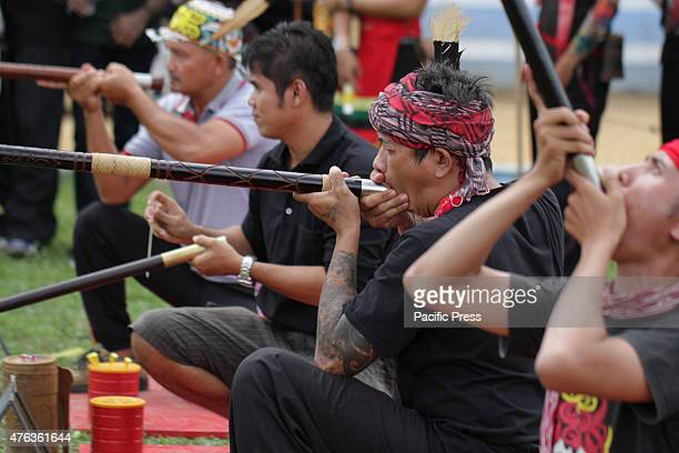 Participants were competing in a Sumpit tournament during the Gawai Dayak Naik Dango Sumpit is a traditional weapon of the Dayak in Kalimantan