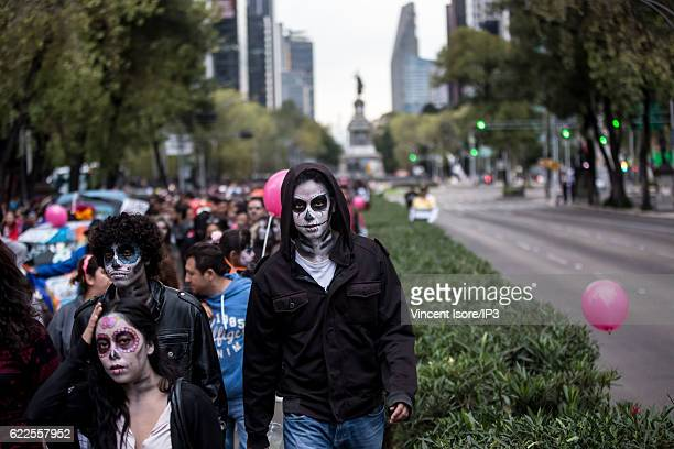 Participants who wear colorful costumes parade through the streets during the 'Alebrije Parade' a joyful annual event celebrated at the Day of the...