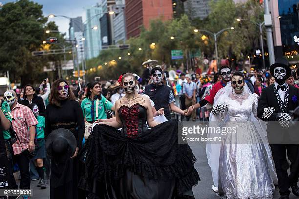 Participants who wear colorful costumes parade through the streets during the 'Catrinas Parade' a joyful annual event celebrated at the Day of the...