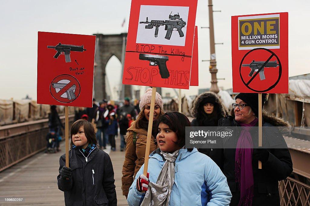 Gun Control Activists March Across Brooklyn Bridge : News Photo