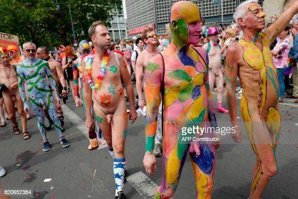 Participants with painted bodies take part in Berlin's annual Christopher Street Day gay pride parade on July 22 2017 Gays and lesbians all around...