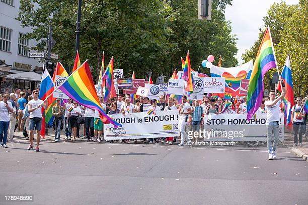 Participants with rainbow flags attend a protest against homophobia in Russia on August 31 2013 in Berlin Germany The Russian government under...