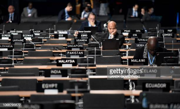 Participants work at the main plenary room during the COP24 summit on climate change in Katowice Poland on December 4 2018 The world is way off...